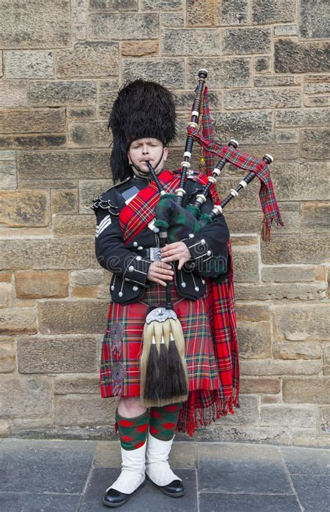 Scotsman Playing The Bagpipes Editorial Photography